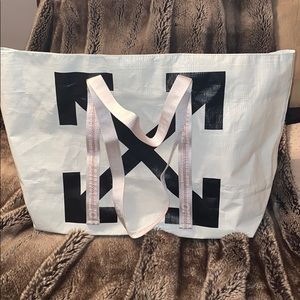 off white pvc tote with tags attached!!